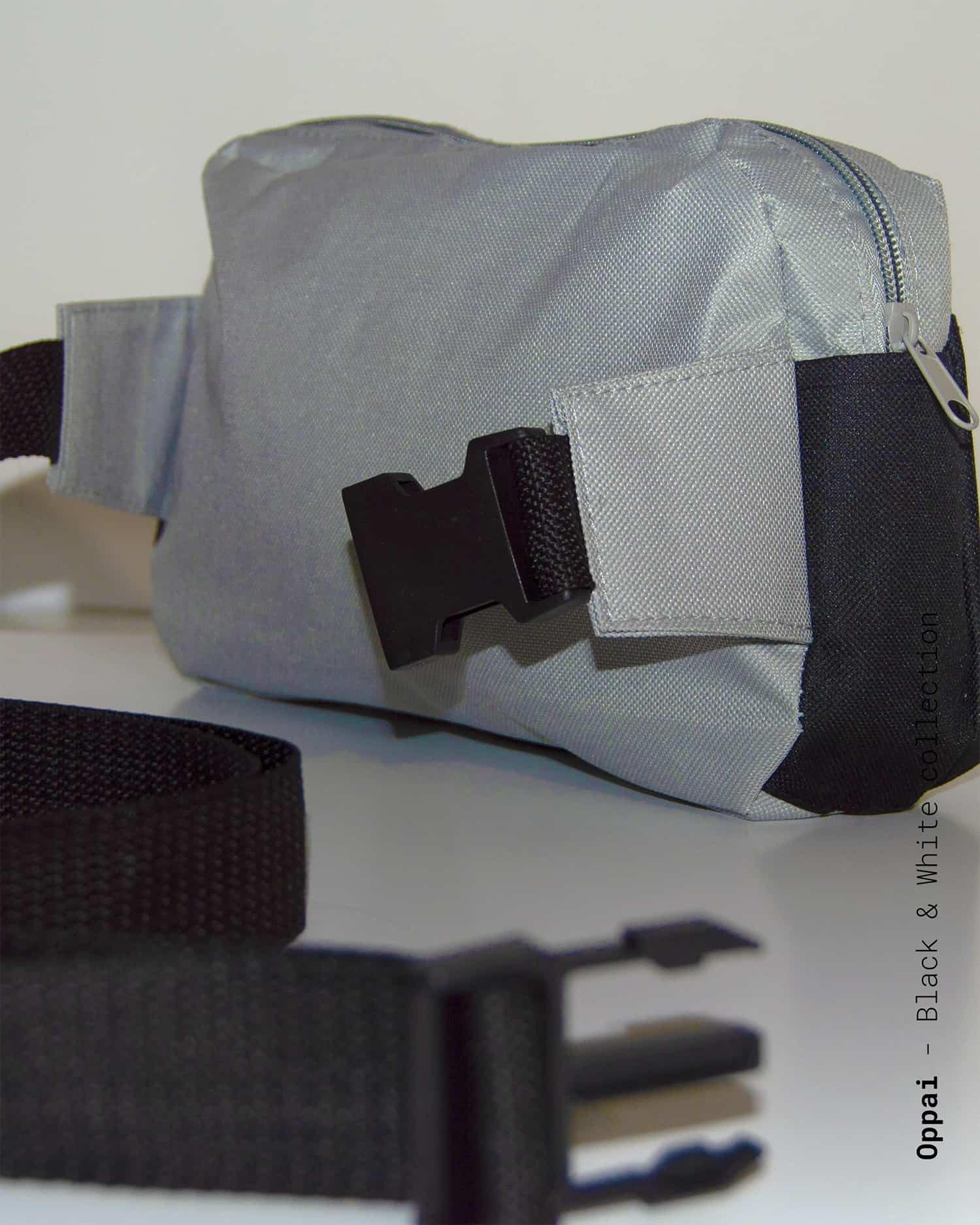 Sacoche noire et grise inspirée de One Punch Man.